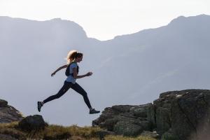female runner in hills